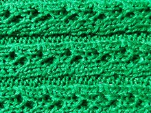 Green Knitted Texture Of Fabric