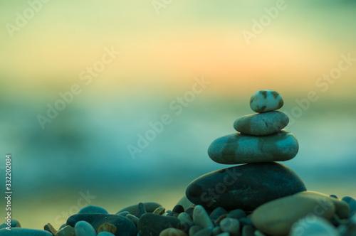 stack of zen stones on pebble beach Wallpaper Mural