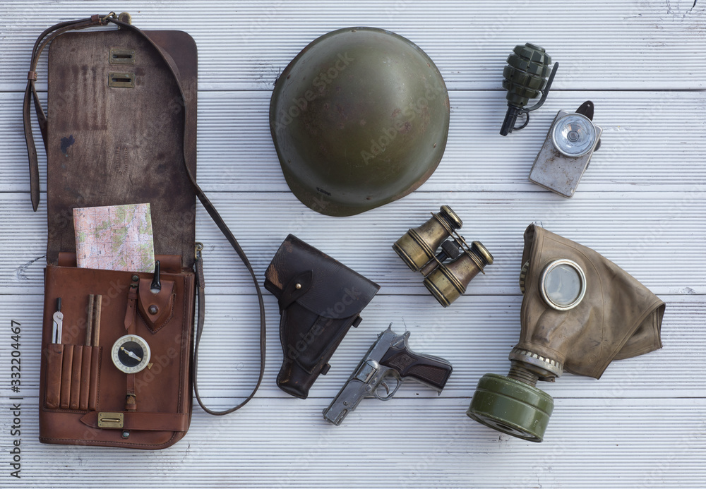 Fototapeta leather map-case, vintage military equipment and weapons