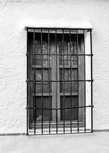 Old Window With Wrought Iron Bars, Black And White Image