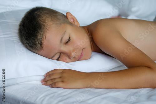 Beautiful little boy morning sleeping under a blanket Canvas Print