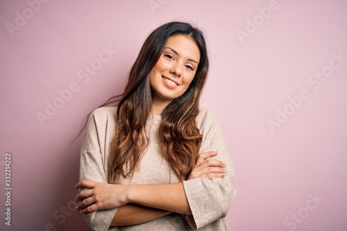 Fototapety, obrazy: Young beautiful brunette woman wearing casual sweater standing over pink background happy face smiling with crossed arms looking at the camera. Positive person.