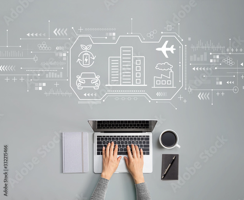 Fototapeta Smart city concept with person using a laptop obraz