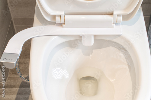 Photo Way to save toilet tissues by using toilet bidet seat add on during covid 19 pan
