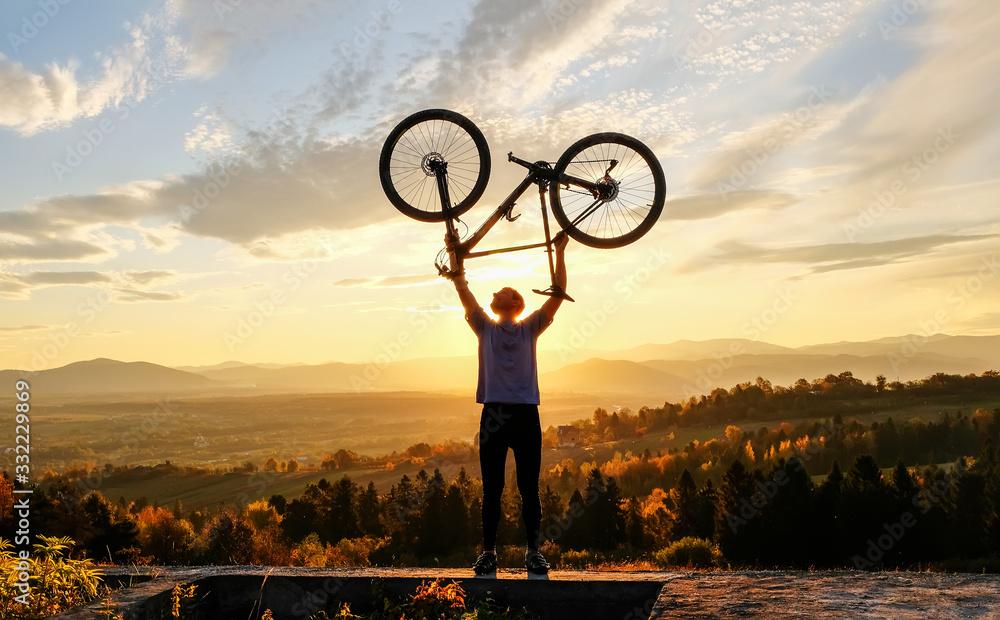 Fototapeta Bike adventure in the mountains