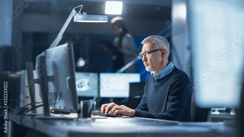 Shot of Industrial Engineer Working in Research Laboratory / Development Center, Using Computer Fototapeta