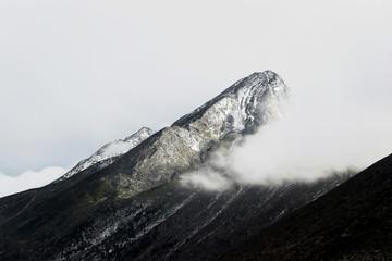 Fototapeta Góry winter landscape of snow mountain peak in fog