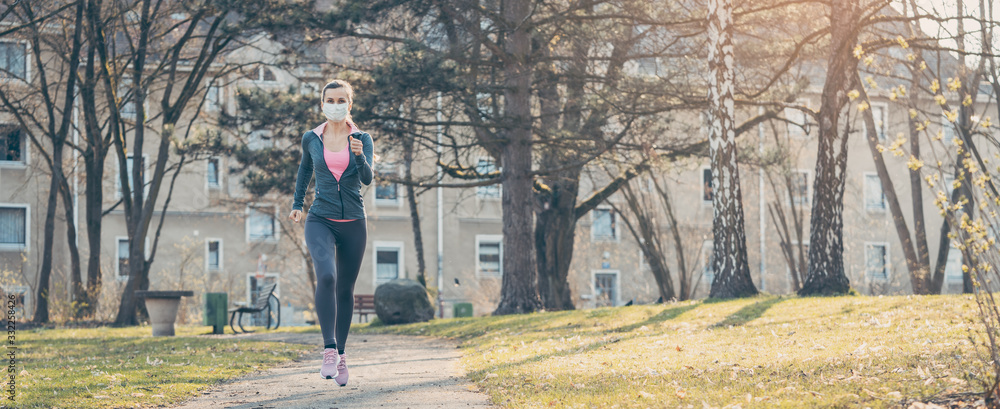 Fototapeta Woman jogging down a path boosting her immune system for covid-19
