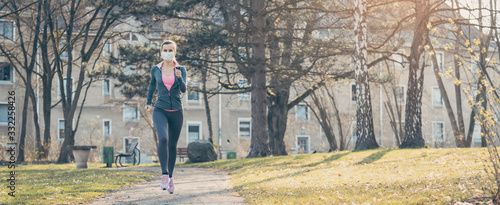 Woman jogging down a path boosting her immune system for covid-19