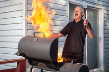 Man With Flaming BBQ Fire