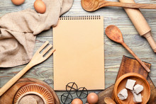 Cook Book With Products On Wooden Background