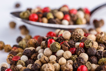 Mix Of Peppercorns On White Ac...