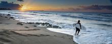 Lone Surfer At A Hawaiian Shor...
