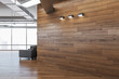 Modern office interior with blank wooden wall.