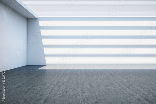 Obraz Contemporary gallery room with empty concrete wall - fototapety do salonu