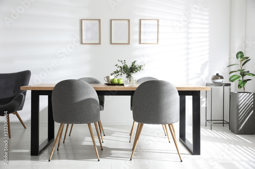 Obraz Stylish room interior with table and chairs. Idea for design - fototapety do salonu