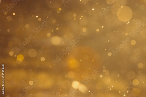 Fotografie, Obraz Dark Abstract Gold bokeh sparkle on black background
