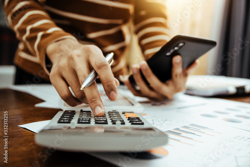 Fototapeta Female accountant or banker making calculation of finance and economy banking concept. obraz