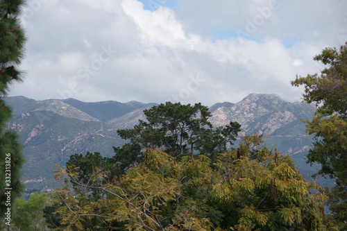 Panoramic view of the Santa Ynez mountains ridge under heavy clouds behind Santa Wallpaper Mural
