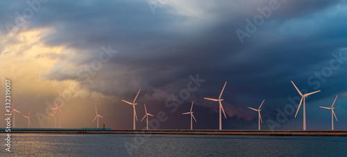 Obraz Offshore wind farm at beautiful, dramatic sunset - fototapety do salonu