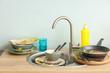 Leinwanddruck Bild - Pile of dirty dishes in kitchen