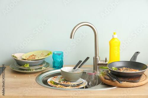Pile of dirty dishes in kitchen Fototapet