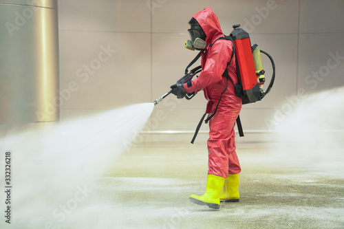 Fototapeta medical officers prepare chemical protection suit and working in airport area to cleaning virus with anti bacteria chemical obraz