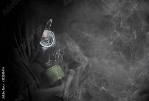 Man in a gas mask in the smoke Canvas Print