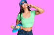 canvas print picture - Woman in Cap Using Smartphone and Smiling Happy