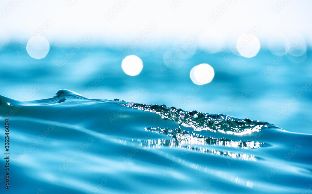 Fototapeta Lights on sea background. Waves.