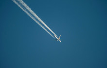 Jet Airliner Flying High In Th...