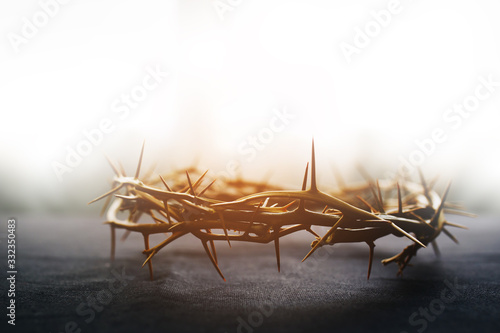 Tela the crown of thorns of Jesus on  black background against  window light with cop