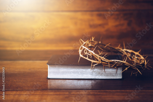 Canvas Close up of crown of thorns of Jesus on top of the holy bible on wooden table ca