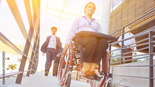 Fotografie, Obraz Woman with a wheelchair on an accessible ramp
