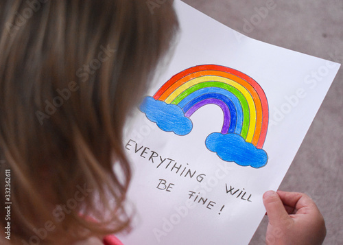 Photo Everything will be fine, is gonna be alright in hand drawing letters and a rainbow with clouds drawn by a child