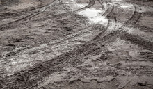Tire Tracks Are On A Wet Rural...