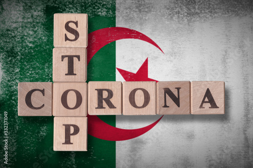 Flag of Algeria with wooden cubes spelling STOP CORONA on it Wallpaper Mural