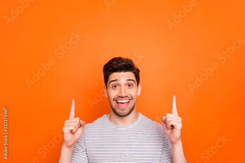 Fotografie, Obraz Closeup photo of attractive funny guy hold hands fingers direct up empty space e