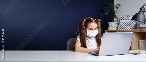 Obraz Distance learning online education. schoolgirl in medical mask studying at home, working at laptop notebook and doing school homework. coronavirus quarantine. - fototapety do salonu