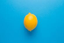 Lemon On A Blue Isolated Backg...