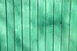Leinwanddruck Bild - Green wooden planking of a fence