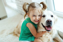 A Child With A Dog. Little Gir...