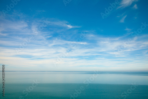 Fototapeta blue ocean waves and sky clouds summer background obraz