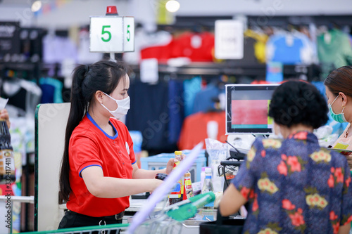 Obraz Cashier or supermarket staff and customers in medical protective mask - fototapety do salonu