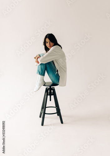 young woman on the white background #332418092