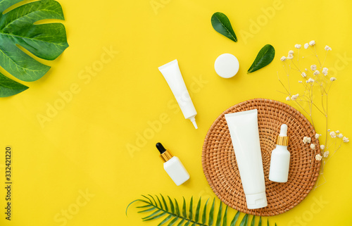 Fototapeta White bottle cream, mockup of beauty product brand. Top view on the yellow background. obraz