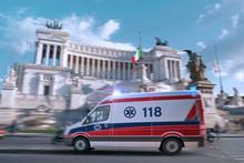 Italy Coronavirus Outbrake Crisis. Ambulance Car Rush To Help, Italian Emergency On Piazza Venezia, Rome, Blurred Motion Shot. Chinese Covid-19 Ncov Corona Virus Flu Disease Pandemic 3D Mixed Media