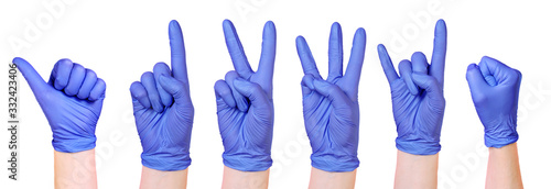 Collection of isolated hands wearing purple medical gloves Wallpaper Mural