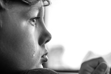 Profile Of A Sad Crying Boy Wi...