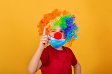 A Child Clown In A Protective ...